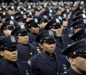 New recruits attend their a New York Police Academy graduation ceremony, Monday Dec. 29, 2014, at Madison Square Garden in New York.