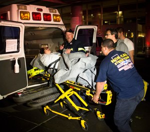 "While paramedics need to maintain their splinting skills, driving practice and stretcher competencies well into their careers, they also need to maintain the advanced skills that make them an ""advanced"" life support care provider. (AP Photo/John Minchillo)"