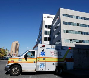 Off-duty Newark EMS providers answered the call for help at University Hospital, where emergency department staff were overwhelmed due to the COVID-19 crisis. A total of 14 off-duty nurses, paramedics and EMTs responded to assist the ED doctors and nurses. (AP Photo/Mel Evans, File)