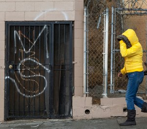 A MS-13, or Mara Salvatrucha graffiti is tagged on a Salvadorean bakery wall in Los Angeles.