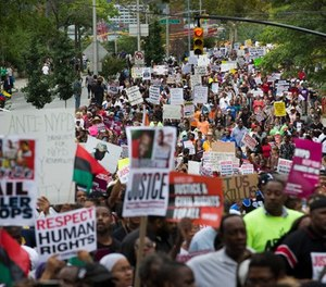 In this Aug. 23, 2014 file photo, demonstrators march to protest the death of Eric Garner in the Staten Island borough of New York.