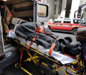 In this Jan. 9, 2013 file photo, an injured ferry passenger is loaded into an ambulance in New York. (AP Photo/Richard Drew, File)