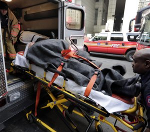 In this Jan. 9, 2013 file photo, an injured ferry passenger is loaded into an ambulance in New York.