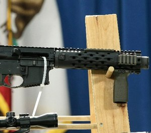 A homemade fully automatic rifle, confiscated by the Department of Justice, is displayed at a news conference held by Sen. Kevin de Leon where he unveiled legislation dealing with so called