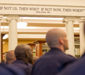 In this Oct. 1, 2015, photo, police recruits in Nashville, Tenn., participate in a program at the downtown library on the history of civil rights in the city. (AP Photo/Erik Schelzig)