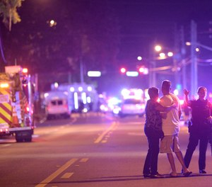 Orlando Police officers direct family members away from a shooting involving multiple fatalities at the Pulse Orlando nightclub in Orlando, Fla., Sunday, June 12, 2016.