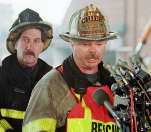 Worcester, Mass., District Fire Chief Michael McNamee talks with reporters on Dec. 6, 1999, about the search for the bodies of five of the six Worcester firefighters who died while battling a fire at an abandoned cold storage warehouse on Friday in Worcester. (AP Photo/Julia Malakie)