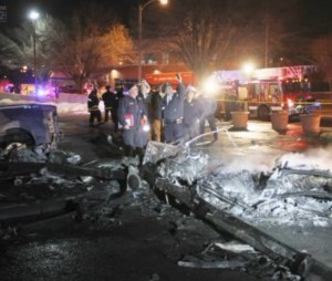 St. Louis Fire Department photo of crash scene and investigation. Pilot killed in crash, just before landing at the hospital.