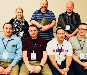 A group of students (Top row: Hailey Palmore, Charles McLeod, Mike Lindsay Bottom Row: Kevin Crocker, Mike Grimes, Dan Marshall, Ryan Strange) is conducting a study on bullying, harassment and critical stress in the EMS industry.