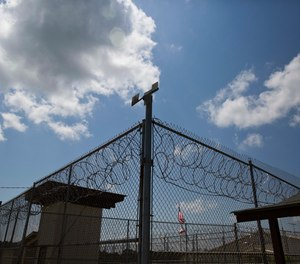 A fence stands at Elmore Correctional Facility in Elmore, Ala.  (AP Photo/Brynn Anderson, File)