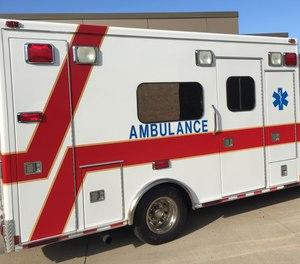 During EMT training practice patient assessment skills inside an ambulance.
