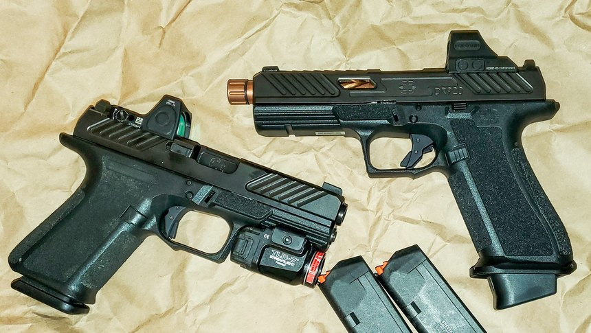 MR920 (left) with a Streamlight TLR-7 and Trijicon RMR attached; DR920 (right) has a Holosun 508T.