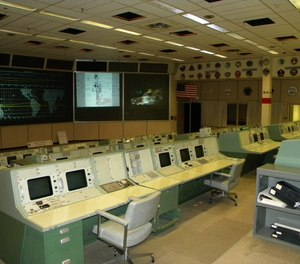 The historic Apollo Mission Control Center in Houston, Texas. A recent restoration returned the control center to how it looked the day Apollo 11 landed on the moon on July 20, 1969. Current space station flights are controlled from an updated control center in the same building.