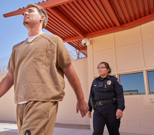 The presence of bodycams recording what actually happens can deter inmates from breaking rules, fighting and making false claims against corrections officers. (image/Axon)