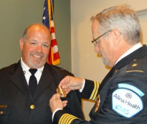 Badge pinning ceremony at Allina Health EMS in St. Paul, Minnesota. President Brian LaCroix pins Supervisor Scott Waibel upon completion of an on boarding process. (Image courtesy of Allina Health EMS)