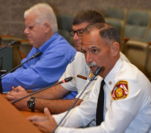 Fire Chief Marc Bashoor advocates for his fire department during a county commission meeting.