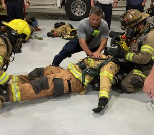 I observed a recent session where 25 firefighters, paramedics and EMTs were working together on firefighter rescue and CPR skills. (Photo/Marc Bashoor)