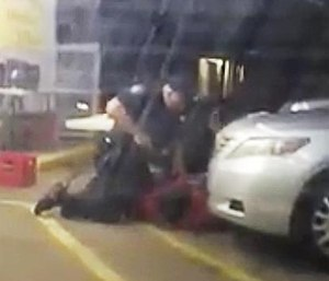 In this photo made from video, Alton Sterling is held by two Baton Rouge police officers, with one holding a hand gun, outside a convenience store in Baton Rouge, La. Moments later, one of the officers shot and killed Sterling. (Arthur Reed via AP)