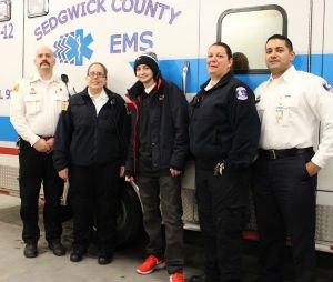 Kyle Begin (center) with Sedgwick County EMS personnel Maj. Kevin Hartley, Paramedic Cassie Powell, Capt. Pam Utter, and Col. Paul Misasi
