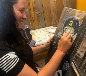 Paramedic Kate Bergen works on a portrait of Sue Keane, a retired Port Authority sergeant who responded to the attacks on Sept. 11, 2001.