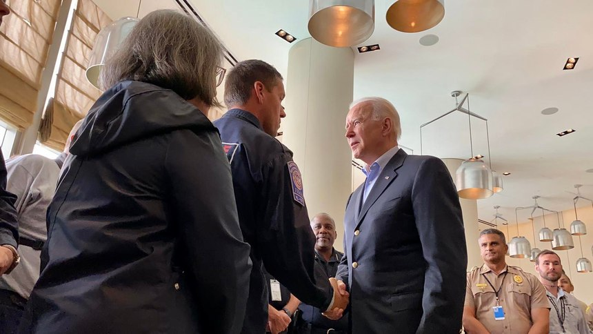 President Biden meets with first responders working the site of the Surfside condo collapose.