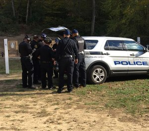 This picture is from a University of Mary Washington firearms training drill where the officer starts the drill seated in the vehicle to simulate a real-world scenario.