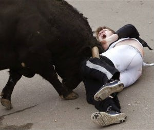 In this photo taken on Saturday, Feb. 14, 2015, Benjamin Miller, 20, from Georgia, in the US, is gored by a bull during the