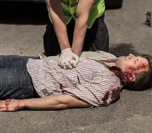 An officer performing CPR.