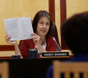 State Sen. Nancy Skinner, D-Berkeley, chairwoman of the Senate public safety committee, displays a copy of Democratic state Sen. Anna Caballero's police-backed law enforcement training bill during a hearing at the Capitol Tuesday, April 23, 2019, in Sacramento, Calif.