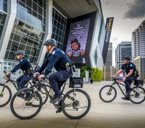 Sacramento, Calif., police officers ride bicycles near the Golden 1 Center