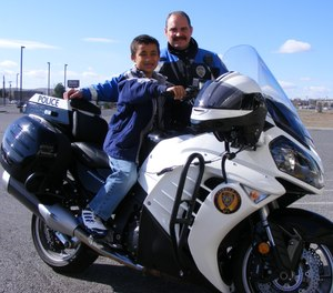 Kennewick Police Officer Mike Bowe's act of generosity of buying this young boy a new pair of shoes was a catalyst for the agency's Community Care Program.