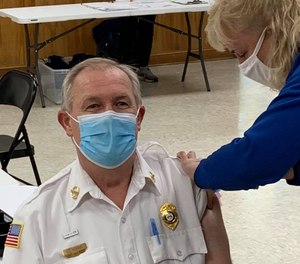 Chuck Kearns, CEO, Chatham Emergency Services, shown here in December, 2020 says about have of the department's employees were vaccinated as of July, 2021.