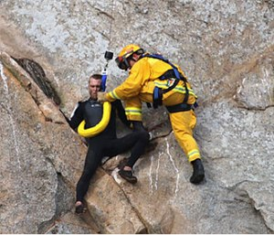 Morro Bay Fire Department Capt. Todd Gailey was lowered from a helicopter by cable to pluck MichaelBanks and take him to safety. (Bob Isenberg via AP)