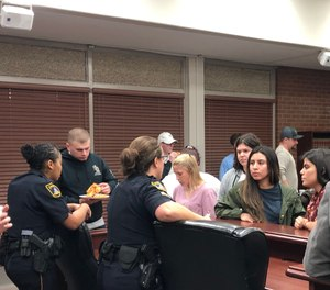 The Topeka Police Department delivered recruiting and hiring presentations to eight classes at the University of Southern Mississippi, then provided pizza for anyone who wanted to meet with officers. That initiative resulted in one hire with three more in the process for the next Academy. (Photo/Matt Cobb)