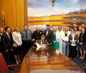 Governor Hickenlooper signs community paramedic bill into law. (Image courtesy Chris Howes)