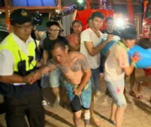 In this screen grab taken from ETTV, injured concert spectators are treated after an accidental explosion during a music concert at the Formosa Water Park in New Taipei City, Taiwan, Saturday, June 27, 2015. The New Taipei City fire department says 200 people were injured in an accidental explosion of colored theatrical powder Saturday night near a performance stage where about 1,000 people were gathered for party.