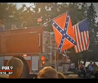 Firefighter suspended for flying Confederate flag at parade