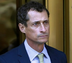 Former Congressman Anthony Weiner leaves federal court following his sentencing in New York. (AP Photo/Mark Lennihan, File)