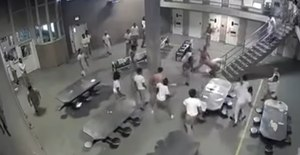 A fight breaks out between inmates at Cook County Jail in Chicago.