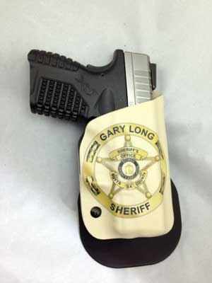 Bob Cook has developed a unique process where he can mold your weapon-specific Kydex holster with your full color badge, shield, or star infused right into the front of the holster.