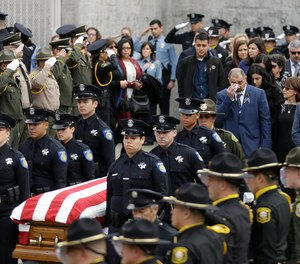 Family members follow the flag draped coffin of Davis Police Officer Natalie Corona before funeral services for Corona at the University of California, Davis, Friday, Jan. 18, 2019, in Davis, Calif. Corona was was shot and killed Jan. 10, responding to scene of a three-car crash in Davis. Police say gunman Kevin Douglas Limbaugh, 48, not involved in the crash, rode up on a bicycle and without warning, opened fire on Corona.