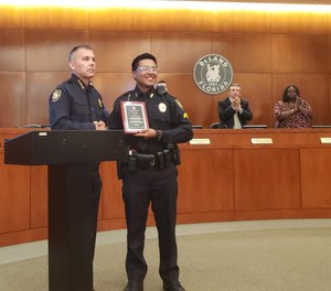 DeLand Police Chief Jason Umberger awards Cpl. Tony Tagle with the Medal of Valor during the City Commission meeting on Monday, May 20, 2019. [NEWS-JOURNAL/KATIE KUSTURA]