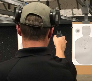 Instructor Joshua Anderkin demonstrates one-handed shooting with dry fire to see what is happening with the dot. Many times, your trigger pull will affect dot movement. (Photo/Sean Curtis)
