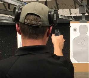 Instructor Joshua Anderkin demonstrates one-handed shooting with dry fire to see what is happening with the dot. Many times, your trigger pull will affect dot movement.