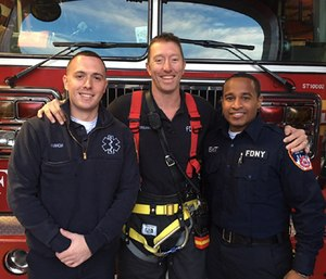 Firefighter Sean O'Rourke reunites with EMTs Adam Harrow and Corey Christian, who administered medical care when O'Rourke was seriously injured last year. (Photo/FDNY)