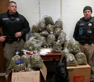 "The marijuana, with an estimated street value of about $300,000, as well as ""multiple containers of concentrated THC,"" were found in the ""truck topper,"" officials said. (Photo/York County Sheriff's Office)"