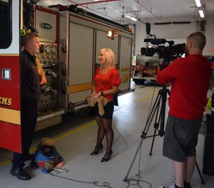A local reporter was invited to this station to meet with a firefighter/paramedic to discuss the need for PPE decontamination after fires. (Photo/Courtesy of Colerain Twp. Department of Fire and EMS)