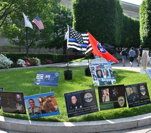 Memorial messages on display at the National Law Enforcement Officers Memorial during National Police Week in May 2018.