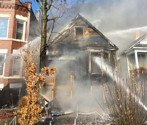 The fire broke out shortly before noon and was quickly raised to a 2-11 alarm, sending extra equipment and crews. (Photo/Chicago Fire Dept.)