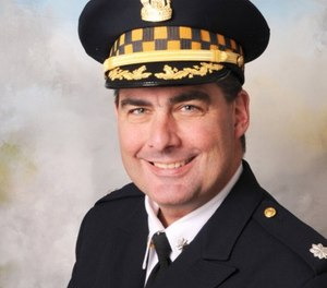 Cmdr. Paul Bauer, 53, had been on the police force 31 years.